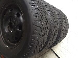 Set of four 195/70/14 studded winter tires like new on rims