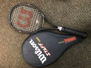 Three tennis racquets with cases