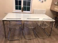 IKEA glass dinning table and 6 Perspex chairs