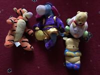 Four Winnie the Pooh figures and a musical book