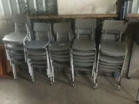 Grey plastic stacking chairs.