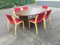 Walnut oval meeting table.