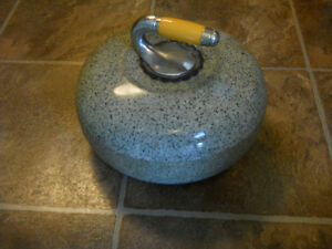 antique curling stone made of granite from the 60's asking $200