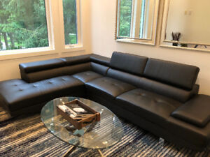 2 Piece Black Leather Look Sectional. Priced to sell!