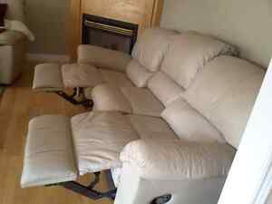 Taupe leather sofa with flip out foot rests
