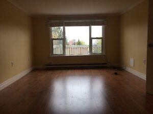 Beautiful spacious 3 bedroom upper triplex unit