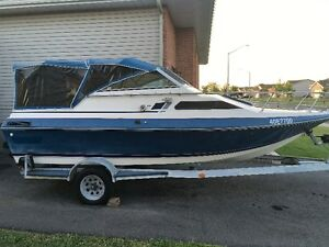 85 Glassmaster 21.5 foot boat with cuddy cabin
