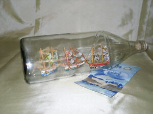 Sale $7.00 Glass Bottle with three mini ships inside