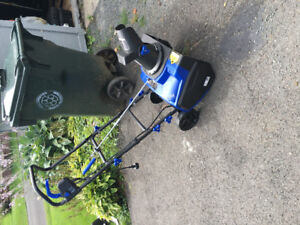 Brand new electric snow blower, used once.