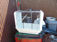 1 bird cage in good shape left by old owner asing $30  514-803-