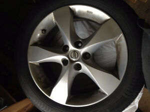 Nissan 17inch OEM Rims and Nokian all season tires