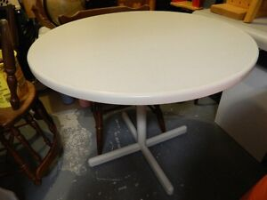 A ROUND TABLE AND 2 CHAIRS