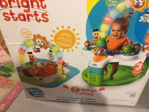 Bright starts activity gym and saucer