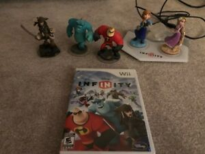 Disney Infinity starter pack + two extra toys to life figurines