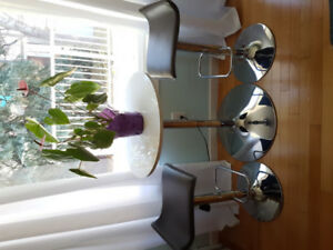 Bistro set, gas lift  table and stools! Lovely for a small space