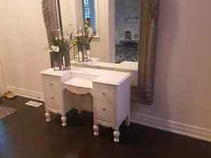 White desk with crystal knobs.