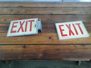 Pair of unlit aluminum exit signs