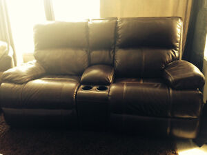 Brown leather power reclining and rocking loveseat