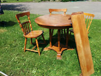 SOLD...PPU     Table with 2 leaves and 2 chairs.