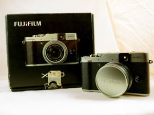 Fuji X20 + strap + Case+  3 Batteries + orig. packing + manuals