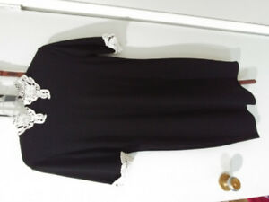 Black dress with neck and sleeve accent, size xl, fits smaller