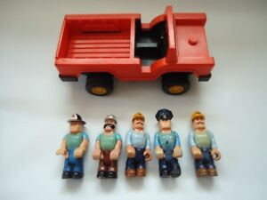 Vintage Fisher Price husky helpers and truck.