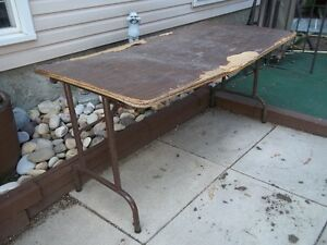 THREE folding tables Tops warped still suitable for garage sales