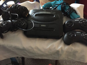 Sega Genesis with 2 controllers plus 2 wireless controllers
