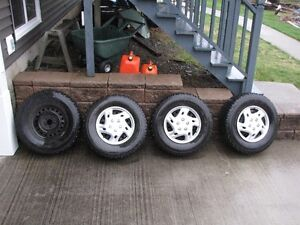 4 Firestone Winter force tires 255/70/16 on Ford factory rims