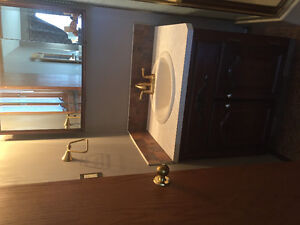 Vanity with sink tap and medicine cabinet mirror
