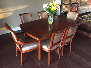 Like new 8 chair antique walnut dining set w/3 ext's, sits 10