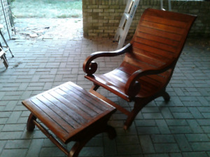 Solid wood lounge chair with foot rest