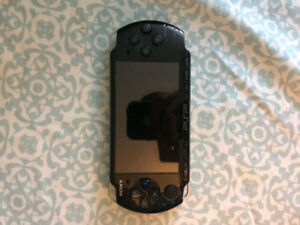 Original PSP with charger and games