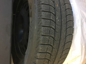 P225 65 R17  Michelin X-Ice Tires on Wheels.   Great shape.