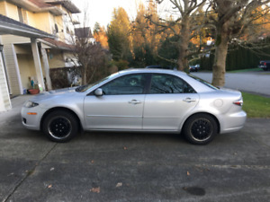 2007 Mazda 6 2.3L 4cyl automatic (with winter tires on rims)