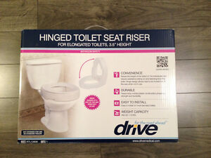 Hinged Toilet Seat Riser/ Adjuster - $40