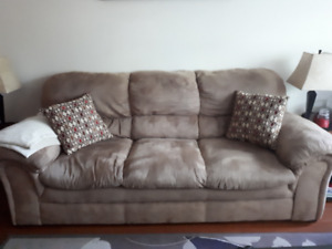 Matching tan colour sofa and love seat with accent pillows