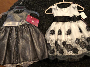 Two brand new with tags 12m dresses