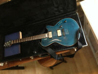 Godin guitar with case and amp