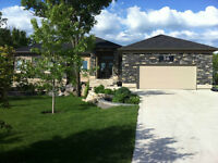 Riverfront custom home on 1.2 acres in La Salle, MB