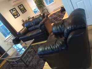 Brown leather loveseat and chair