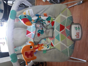 Infant bouncy and vibrating chair with lullabies.