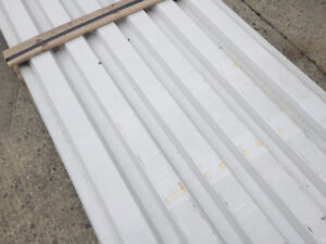 NEW SHEETS OF WHITE STEEL FOR WALLS OR CEILINGS OR FENCE