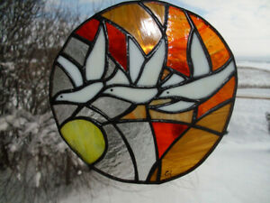 Stained glass birds flying