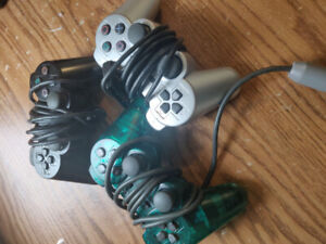 Selling two original Playstation II controllers