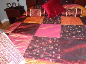 Burgundy and gold color double comforter, bed skirt and pillows