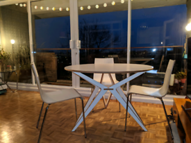 Round dining table and chairs in white