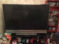 Jvc 70 inch tv with black glass stand