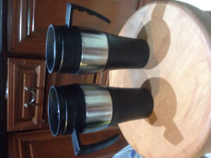 A pair of travel coffee mugs