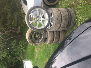 Two sets of tires off of a 2000 Honda Civic